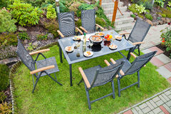 Metal Garden furniture. The metal Garden furniture by the house and the pool Royalty Free Stock Image