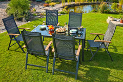 Metal Garden furniture. The metal Garden furniture by the house and the pool Stock Images