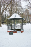 Metal garden furniture. In the old park on a winter day Royalty Free Stock Photo
