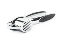 Metal garlic press utensil isolated. Over the white background Stock Photography