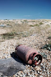 Metal gas cylinder dumped beach Royalty Free Stock Photos