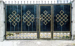 Metal gate with Endless knot symbol Stock Images