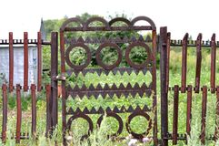 Metal gate in the garden Stock Image