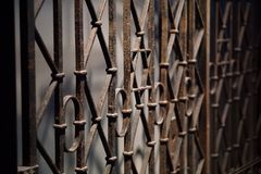 A metal gate with Jewish symbol in the middle. A metal gate with the Star of David in the middle Stock Image