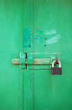 Metal gate lock on green gates. Royalty Free Stock Photography