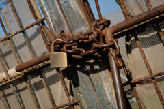 Metal gate locked with chain and padlock Stock Image
