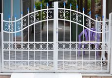 Metal gate of private garage stock photos