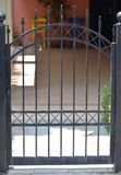 Metal gate of private house stock photo