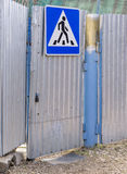 Metal gate with road sign pedestrian crossing Royalty Free Stock Image