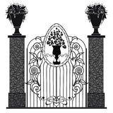 Metal gates. Art nouveau style, and stone pedestals with floral vases Royalty Free Stock Images