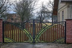 Metal gates. Are decorated with brown boards Stock Photos