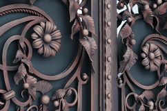 Metal gates with decorative elements. Forged Products royalty free stock image