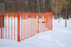Metal gates and fence in a park at wintertime.  Royalty Free Stock Images