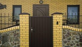 Metal gates modern yellow brick Stock Photography