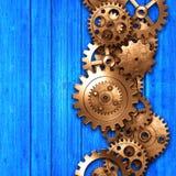 Metal gear on blue rustic wood board. Stock Image