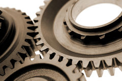 Metal gear cogs. Closeup of metal gear cogs isolated on white background Royalty Free Stock Photos