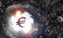 Metal gear mechanism. Cogwheels gear mechanism and euro currency sign Royalty Free Stock Photography