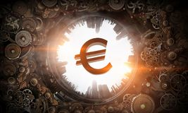 Metal gear mechanism. Cogwheels gear mechanism and euro currency sign Stock Images