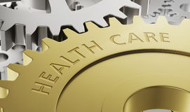 Metal gear wheels with the engraving Health Care Royalty Free Stock Photography