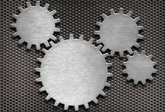 Metal gears and cogs background. Metal gears and cogs on grid Stock Images