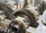 Metal gears group complex industrial mechanism. Metal gears and mechanism close up Royalty Free Stock Photos