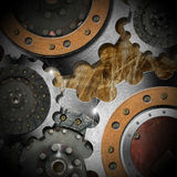 Metal Gears on Grunge Background Stock Images
