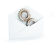 Metal gears in the mail envelope Stock Image