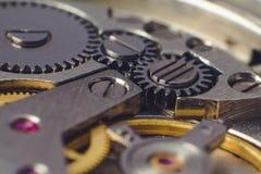 Metal gears of old clock mechanism.  Royalty Free Stock Photo