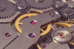 Metal gears of old clock mechanism.  Stock Photo