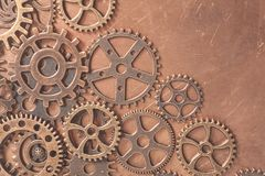 Metal gears wheels. On a copper background royalty free stock photo