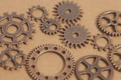 Metal gears wheels. On a copper background Stock Images