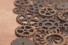 Metal gears wheels. On a copper background Royalty Free Stock Image