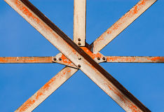 Metal girders crossing with screws. Stock Photos