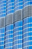 Metal glass facade blue colour of skyscraper. Fragment of the modern building. Many windows pattern.  Royalty Free Stock Photos