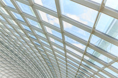 The metal and glass roof inside of office. Center Royalty Free Stock Photos