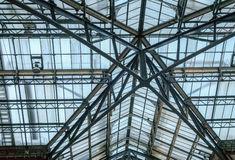 Metal and glass roof, symmetrical. This is a shot of the roof at Liverpool Street Station in London Stock Images