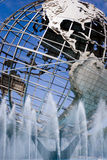 Metal globe. Fountains on the background of large metal globe Stock Photos