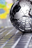 Metal globe. Notebook & puzzle earth chrome globe Stock Photos