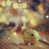 Metal gold Jingle Bell with star on Wooden Table Stock Image