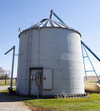 Metal Grain Silo. A modern corrugated metal grain silo on a farm in central Ohio Royalty Free Stock Images
