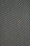 Metal Grate. Vertical wavy silver lines of a metal grate on a pathway stock photography