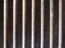 Metal grate. Rusty bars of metal grate on BBQ grill stock photo