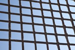 Metal grate against a blue sky Stock Image