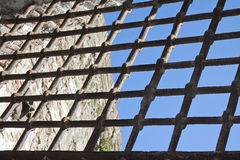 Metal grate against a blue sky Stock Photography