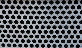 Metal grate with holes. Metal grate with round holes Royalty Free Stock Photos