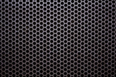 Metal Grate Texture. A metal grate with circular openings Stock Photo