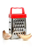 Metal grater and garlic Stock Images