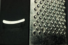 Metal grater with smile Stock Photography