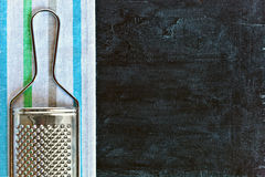 Metal grater and tablecloth Royalty Free Stock Images
