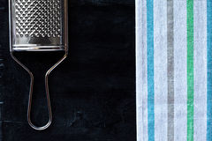 Metal grater and tablecloth Stock Image